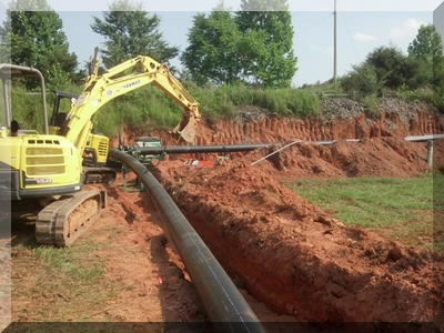 backhoe digging trench
